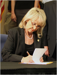 Jan Brewer signing AZ IM Law