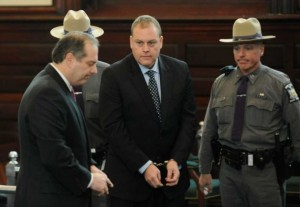 McDonough in handcuffs