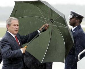 GWB holding his own umbrella