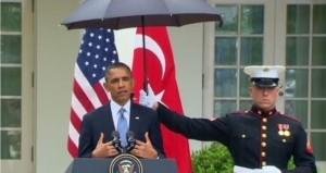 Marine holding umbrella for Obama